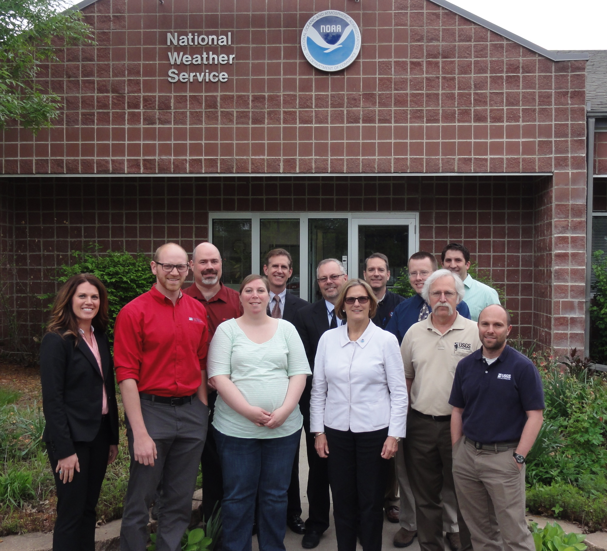 Back Row: Craig Cogil, NWS Des Moines Lead Forecaster; Jim Keeney, NWS Central Region Warning Coordination Meteorologist; Jeff Johnson, NWS Des Moines Acting Meteorologist in Charge; Brad Small, NWS Des Moines Lead Forecaster; Jeff Zogg, NWS Des Moines Senior Service Hydrologist; Kurt Kotenberg, NWS Des Moines Meteorologist Intern Front Row Left to Right: Jami Haberl, Safeguard Iowa Partnership Executive Director; Jesse Traux, Safeguard Iowa Partnership Program Manager; Mindy Beerends, NWS Des Moines General Forecaster; Dr. Kathryn Sullivan, NOAA Administrator and Under Secretary of Commerce for Oceans and Atmosphere; Greg Nalley, USGS Iowa Water Science Center Associate Director; Jon Nania, USGS Iowa Water Science Center Acting Director