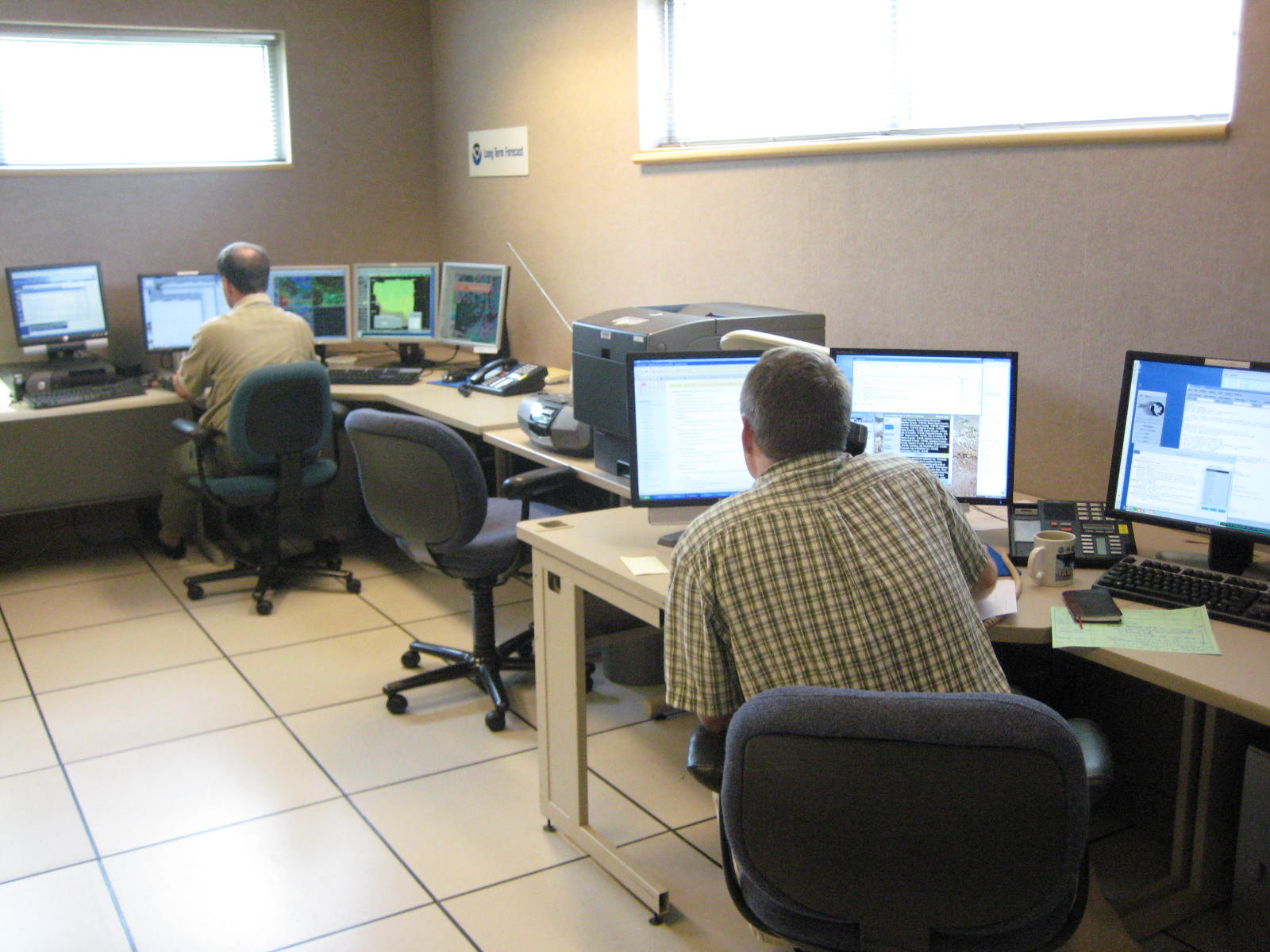 The NWS Des Moines Office on June 9, 2008. Roger Vachalek on the left and Rich Kinney (now at DVN) on the right.