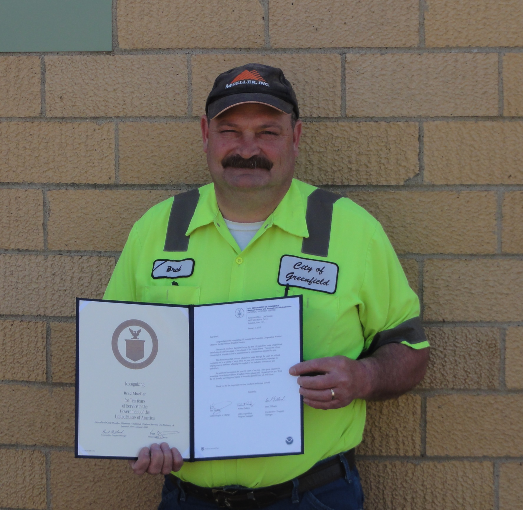 Brad Mueller of Greenfield, IA (pictured) recently received his 10 year Length of Service Award. Presenting the award was Brad Fillbach, HMT, WFO Des Moines, IA
